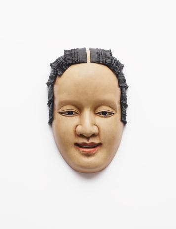 Fibreglass mask, oil paint, hairpins 29 x 19 x 3 cm