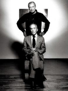 Leo Castelli seated with artist Jasper Johns standing behind, c. 1970s